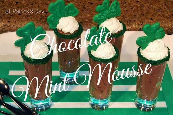 Chocolate Mint Mousse made with fresh heavy whipped cream, dark minted flavored chocolate and served in a small shot glass rimmed with green coarse sugar and candy shamrocks.  Recipe and video how to at http://lizbushong.com/chocolate-mint-mousse/