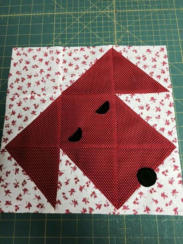 Nine patch puppy -- half square triangles and squares, with a couple of little applique pieces to make the eyes and mouth. Easy!