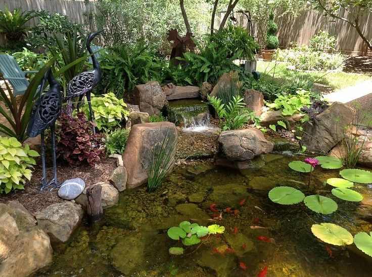 Charming backyard water garden in richmond tx features a for Plastic garden ponds