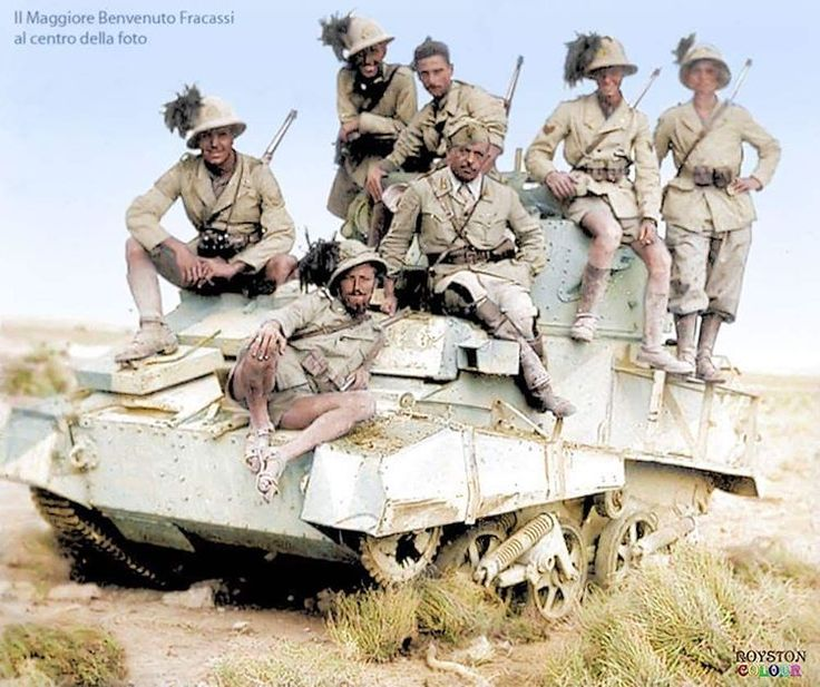 Italian soldiers belonging to the 7th Reggimento Bersaglieri climb atop and pose for a photo on a Vickers MK VI light tank. Tobruk, Libia, 1941.