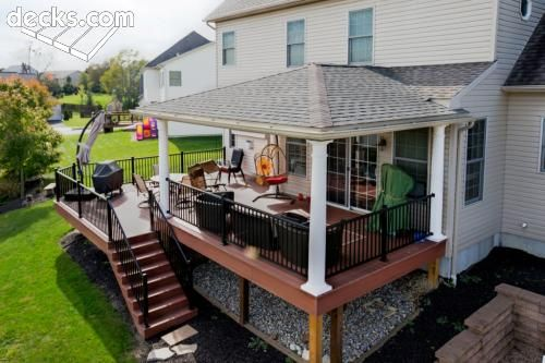 With a hip roof design, this covered deck provides a comfortable outdoor space for dining or relaxing.