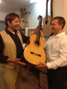 Stephen Hill, Luthier hands  Gary Ryan, World Class Classical guitar player, his new guitar