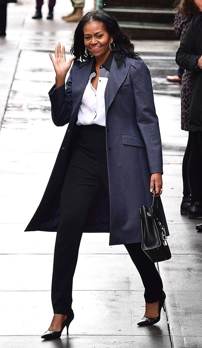The former first lady was seen leaving Upland restaurant in NYC after having lunch with Barack and U2's Bono on March 10, 2017. Michelle rocked a cool gray trench coat, a white and black blouse and skinny-leg black pants.