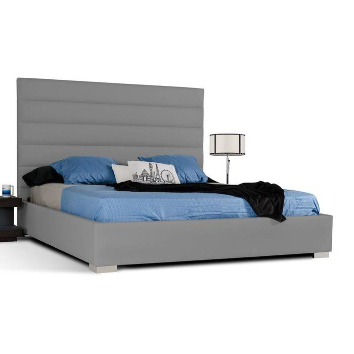 The elegant Patterson platform bed attracts attention due to its linear upholstered headboard. The tall headboard is upholstered in leatherette and features a gently rolled design. Corner stainless steel legs raise the platform bed off of the ground to even out the composition.