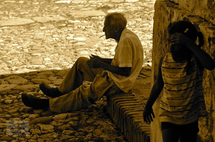 A Cigarette and a Seat on the Curb photo | 23 Photos Of Havana
