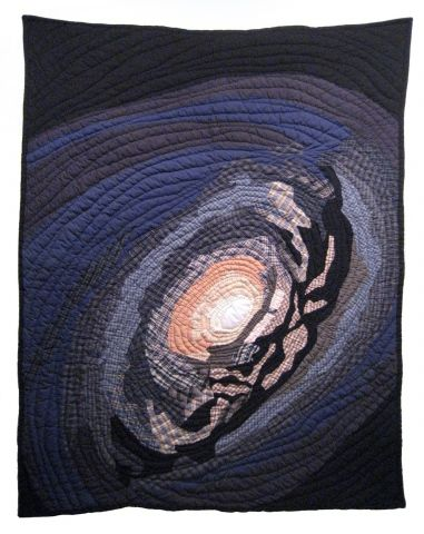 """M64 quilt by Jimmy McBride. """"Artwork"""" link has more quilted reproductions of astronomical phenomena and science fictional structures."""