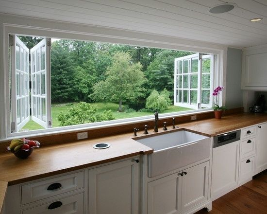Kitchen windows over the sink that open to the deck out back.