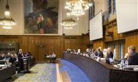 オランダ・ハーグで開かれた仲裁裁判所の口頭弁論=2015年11月30日(同裁判所提供・共同)