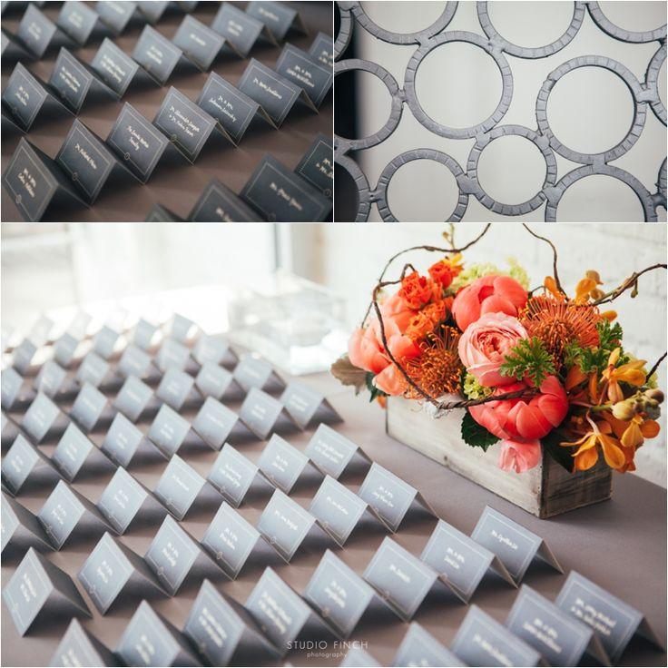 Studio Finch Photography. Vale of Enna flowers. Room 1520. Mokara Orchid. Garden Rose. Spray Rose. Pincushion Protea. Scented Geranium. Dusty Miller. Escort Card Table. Chicago Wedding.