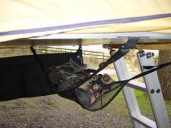 camping storage shoe-hammock accessory for a roof top tent