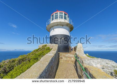 http://www.shutterstock.com/pic-217959946/stock-photo-cape-point-is-located-near-the-city-of-cape-town-south-africa-the-peninsula-has-towering-rock.html?src=pp-same_artist-217959949-1 Cape Point Is Located Near The City Of Cape Town, South Africa. The Peninsula Has Towering Rock Cliffs And Lighthouse That Overlook The Beautiful Ocean View. A Tourism And Travel Hot Spot. Stock Photo 217959946 : Shutterstock