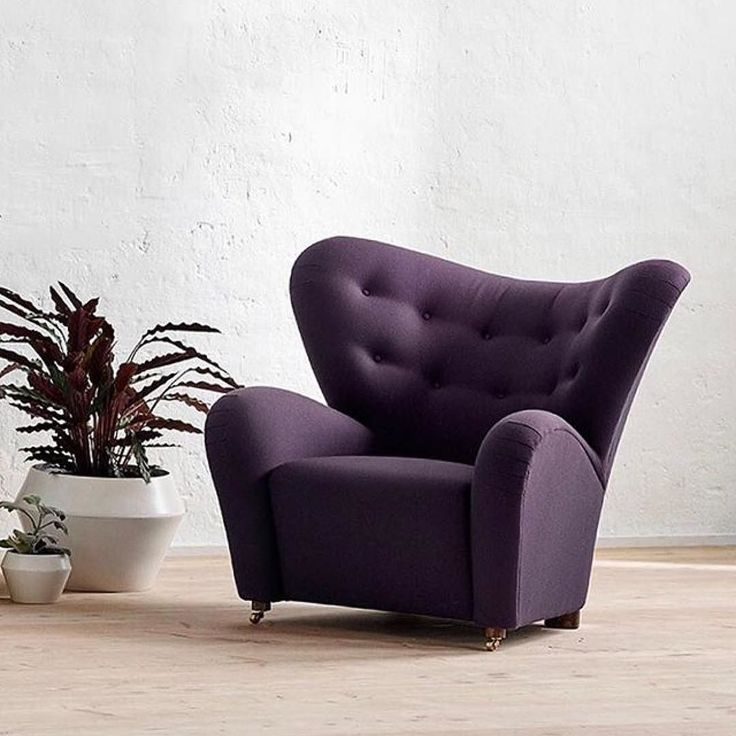 Fab #nursing chair too @bylassen This season's Tired Man in a deep plum colored textile has an extravagant and sophisticated expression that lets the chair stand out even more. . #bylassenthetiredman #thetiredman #dentrættemand #armchair #lænestol #flemminglassen #easychair  #bylassen #bylassencopenhagen #danishdesign #designdenmark #danishdesign #interiordesign #scandinaviandesign #nordicdesign #designclassic