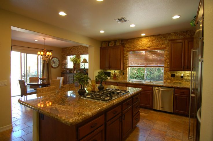 Kitchen, Beautiful Kitchen Design With Backsplash Ideas For Granite Countertops High Gloss Finish Brown Granite Countertops Plus Electric Refrigerator With Ceramic Flooring Plus Four Dining Chairs: Awesome Uniquely Kitchen Cabinet Styles