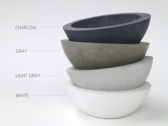 Hand made concrete bowls. Cast using a composite concrete available in white, light gray, gray, or charcoal color. Perfect as a fruit bowl or