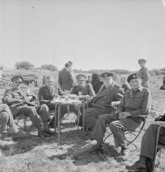 An alfresco lunch taken by British Prime Minister Winston Churchill, together with General Sir Bernard Montgomery and other senior officers of the Eighth Army, during Churchill's visit to Tripoli.