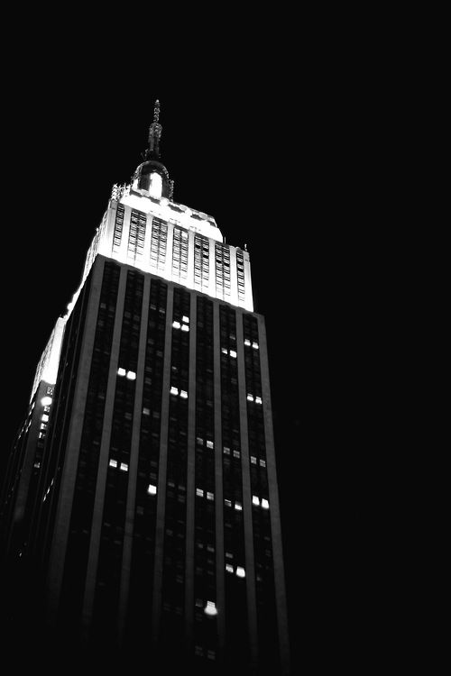 A great photography of the Empire State Building in a extreme black and white shot.