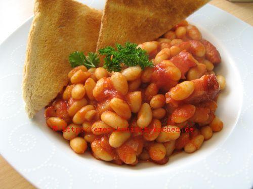 Rezept: Baked Beans- gebackene Bohnen Zutaten: Für: 2-3 Portionen ca.250 g getrocknete, weiße Bohnen (über Nacht in Wasser eingeweicht, dann in Salzwasser 25 Minuten gekocht) -> ODER: 350-400g weiße Bohnen aus der dem Glas (geht schneller, da schon passend gekocht) ca. 4 EL Tomatenmark Salz und Pfeffer- nach Geschmack 2 …