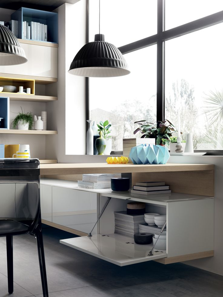 The degree of personalisation this kitchen can offer is truly amazing: for example, a base unit's monochrome top basket can be combined with two lower baskets that fit into the same space but with different sizes and colours.