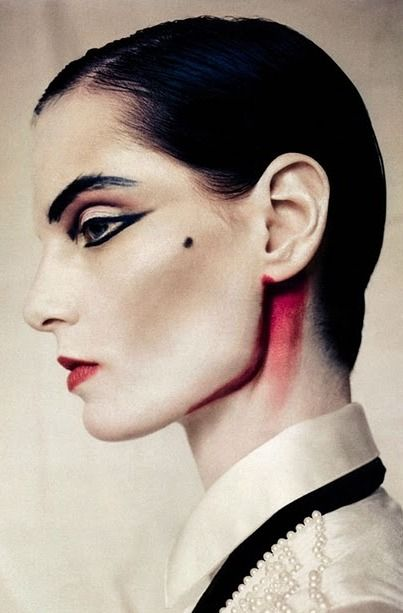 Edgy MakeUp and sleek back hair for a Photo Shoot. Photo by Paolo Roversi red under ear and jaw