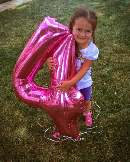 every year on her birthday, I take a picture of my daughter hugging a number balloon