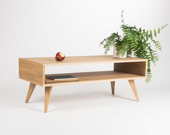 Our coffee table is a piece of furniture, which thanks to its gentle form - inspired by the mid-century modern Scandinavian design - offers various applications. Its symmetry opens another, new possibilities - you can place it next to the wall or in the middle of the living room. Our table, made of solid oak wood and wood covered with natural oak veneer, has been perfectly finished with hard oil wax. This type of finishing allows the wonderful grain patterns to shine through and perfectly…