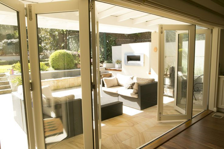 Bi-fold doors make the most of your entertaining space. www.brindabellahomeimprovements.com.au