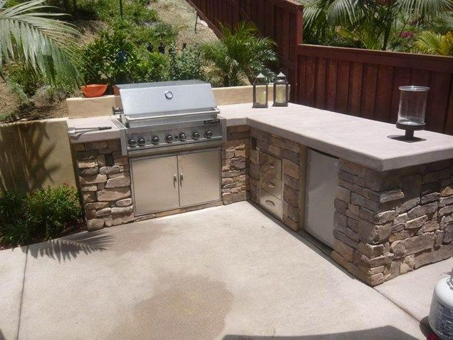 L shaped outdoor kitchen stone veneer concrete for Outdoor kitchen wall ideas