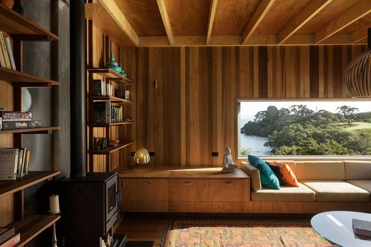 wood panelled living room of my dreams in new zealand