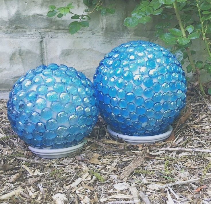 She places a glass light globe in a terra cotta saucer and a few steps later...I LOVE this front yard idea!