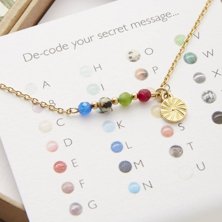 A personalised secret message necklace, handmade with semi precious gemstones.For Mum why not choose a child's name or children's initials, or something simple like LOVEYOU. For a loved one, choose the name of a significant place or a word that has special meaning that only you and your partner know. Best friends, sisters and bridesmaids will love 'BFF' (best friends forever), PEAS (in a pod) or STAR. Words like DREAM, WISH, and FLY are popular positive messages for leaving gifts and good…