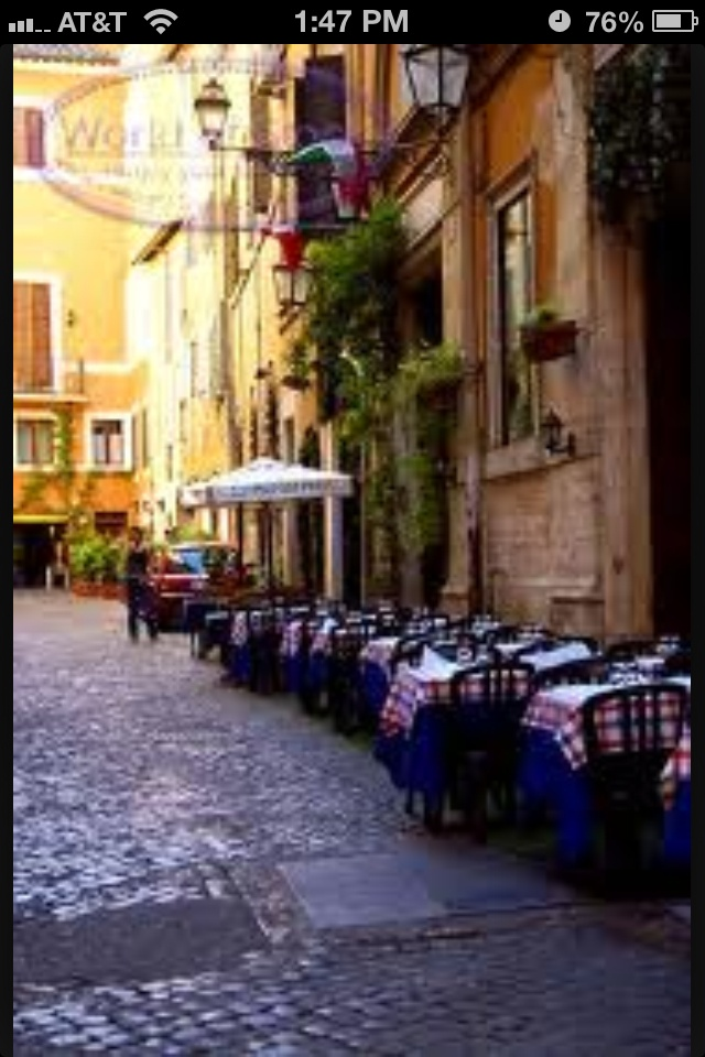 Eat at a sidewalk cafe in Italy!