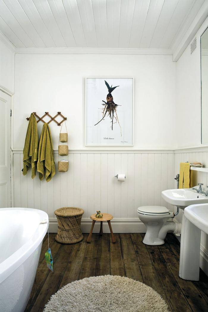 The Tan And Olive Green Accents Go Perfectly With The Brown Floor In This  Bathroom. They Also Offset The Pure White Walls For A More Earthy Look.