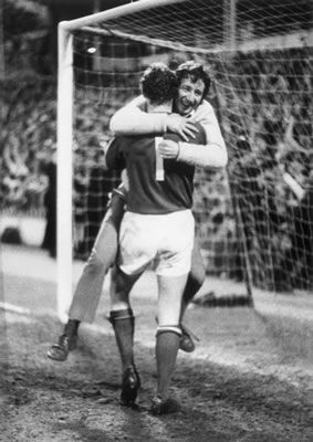 "Arsenal win the League championship at the Lane in 1971 and goal keeper Bob Wilson is embraced by a happy ""gooner"""