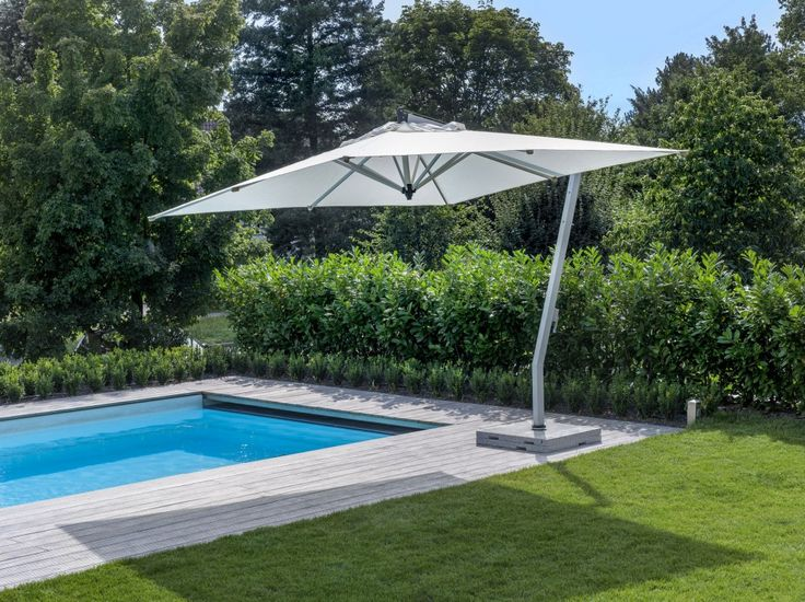 Awesome Offset Patio Umbrella With Green Grass And Swimming Pool Also Trees  Around The Green And
