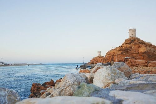 Watch tower in at coastline in Sur Oman by Nuchylee  sky sunrise city sea sunset water beach travel blue sun light ocean rock tower vacation old tourism