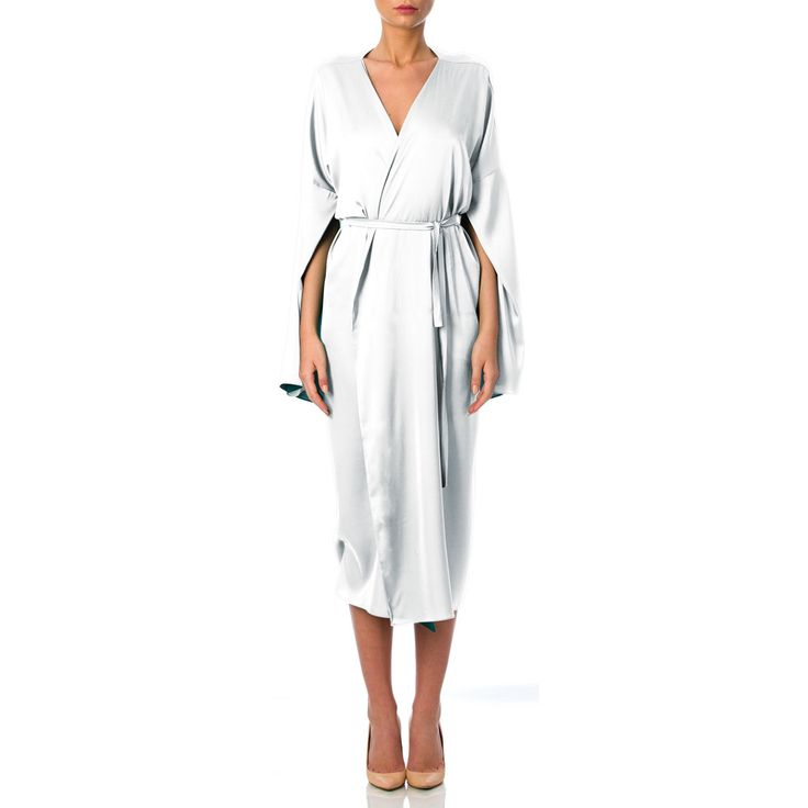 This season's VIP, the robe-like dress can be worn over jeans or solo just like a wrap dress. This style is cut from silk matte satin and detailed with sumptuous sleeves. Wear it on whiteor green with platforms to feel easy.  Green&WhiteSilk Matte Satin  Fluid textil  Wash by hand  The model is 176 cm tall and is wearing a size 38.  If you need this product made to fit your needs and measures, book an appointment in our studio at i@laurahincu.ro for Private Fashioning.