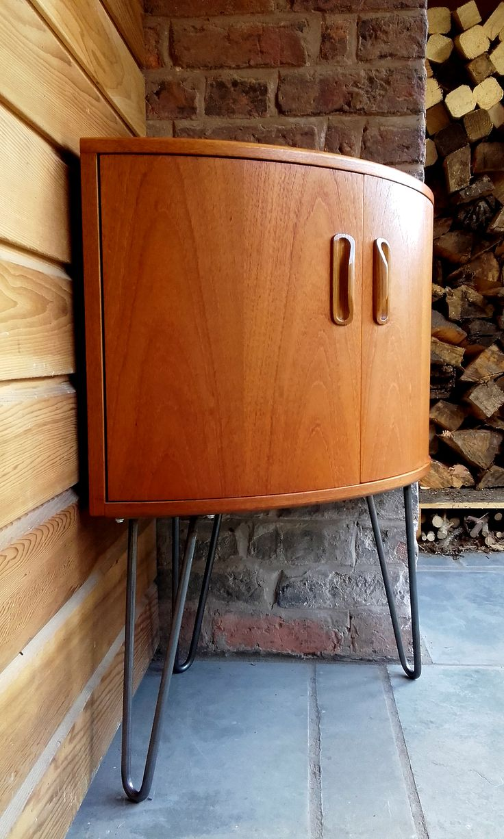 1970s G-Plan Fresco corner cabinet has been put on cool industrial hairpin legs and would make a fab drinks cupboard.  It features the Fresco range's trademark curvy handles and would look great in any mid-century modern or contemporary interior.