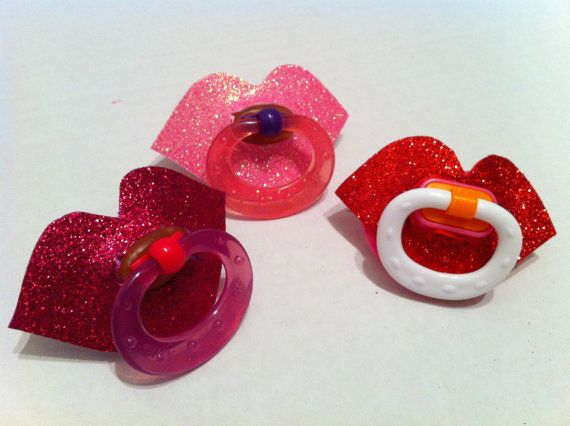 Heehee! I love these! This is for ONE sparkle lips novelty pacifier (please choose from the colors shown) for baby girls! The sparkle lips are made from glitter foam paper that is adhered to the pacifier. Let me know if there is a certain size pacifier that is needed. Also, I have red, hot pink and light pink glitter to choose from. The color of handle varies on the pacifiers. Thanks. #timelesstreasure