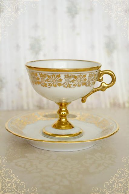 Beautiful footed cup & saucer