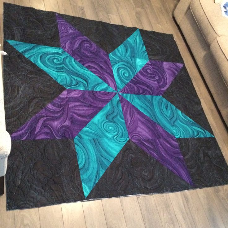 My beautiful star quilt is finally long armed now to bind