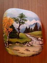 *A beautiful landscape captured on a river rock...