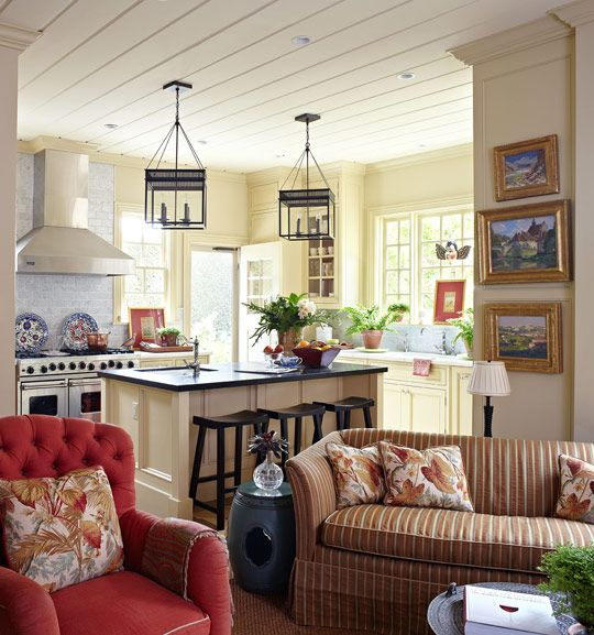 This family's kitchen/art gallery is now used less for cooking than to display the couple's plein air paintings. Hanging lanterns are from Urban Electric - Traditional Home®