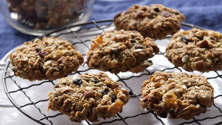 All the hearty goodness of home-made granola, in a biscuit. Take them from the oven while still soft, and as they cool they will harden into crunchy-edged biscuits with slightly fudgy centres.