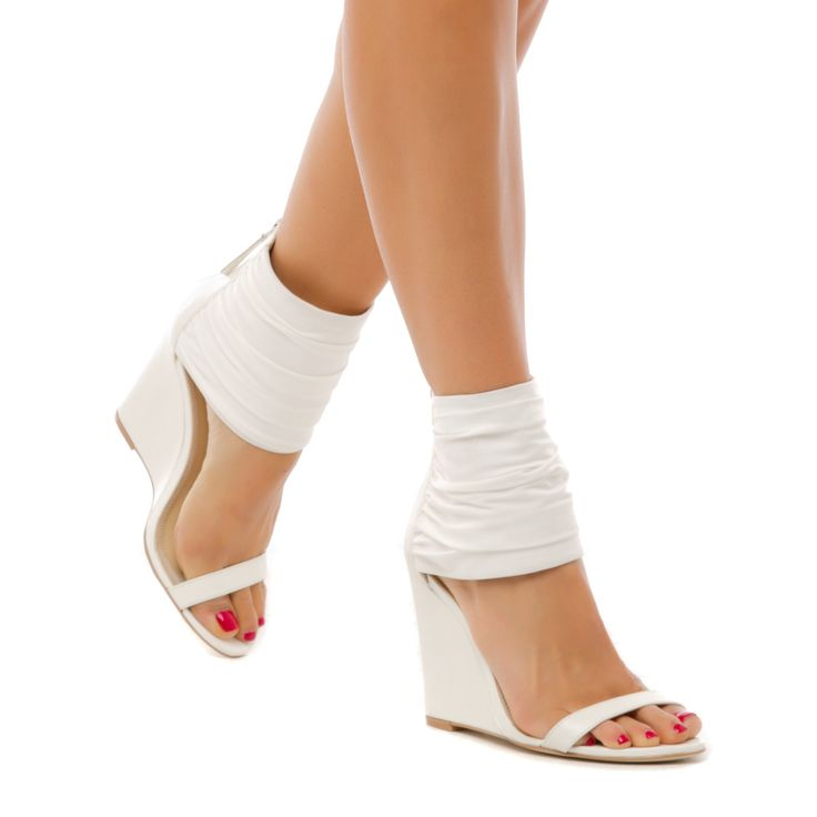 This Luxe Wedge sandal from Izabella Rue features a stretchy ankle panel for additional intrigue. At night, show off its ultra-flattering look with bronzed legs
