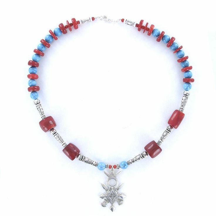 Croix du sud en argent, turquoise et corail de marque Laoula