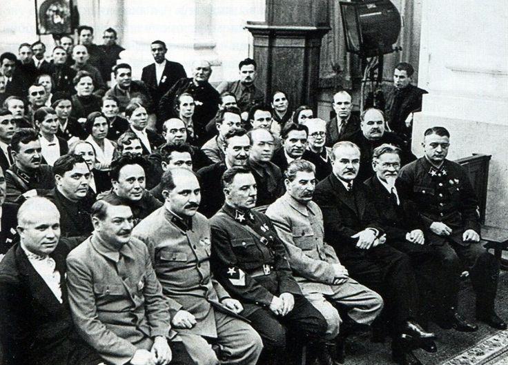First row seated (left to right): N. With. Khrushchev, Zhdanov, L. M. Kaganovich, K. E. Voroshilov, Stalin, V. M. Molotov, M. I. Kalinin, M. N. Tukhachevsky.  Winter 1936.