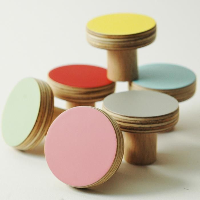 Wooden Knobs in a range of colors including happy yellow, romantic pink, vintage red, and a calming turquoise blue