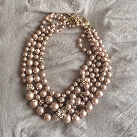 Rose gold pearl necklace Rose gold pearls with small diamond-looking balls. Great statement necklace. Worn once Jewelry Necklaces