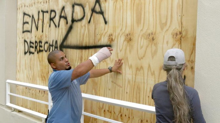 Employees of of the Courtyard Marriott Hotel board up windows as they prepare for the arrival if Hurricane Irma, in San Juan Puerto Rico, Wednesday, Sept. 6 2017. Heavy rain and 185-mph winds lashed the Virgin Islands and Puerto Rico's northeast coast as Irma, the strongest Atlantic Ocean hurricane hurricane ever measured, roared through Caribbean islands on its way to a possible hit on South Florida. (AP Photo/Danica Coto)