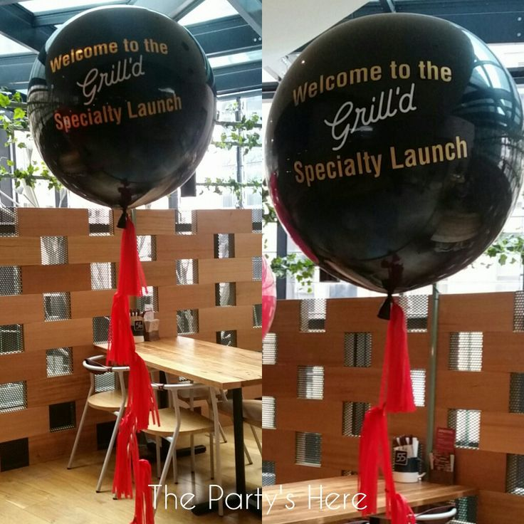 90cm Jumbo Balloons with custom made tassels and lettering. The perfect branding for a new product launch.